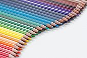 Group of colorful vibrant colored pencils on white background poster