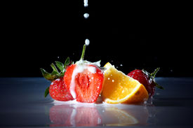 Milk Drop Into Fresh Fruit