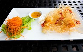 Appetizer of Thailand Mixed Crispy Rice Noodle Deep fried wrapped shrimps with noodle served with vegetables