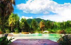 View of sandy beach pond with forest around. Thailand Phuket