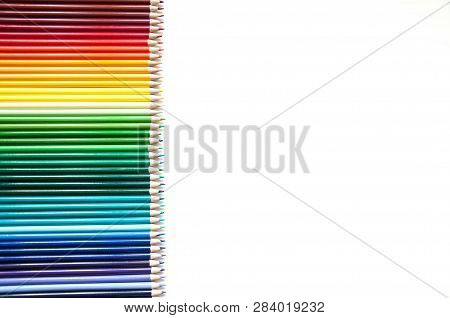Many Multi-colored Pencils. Background With Color Pencils. Rainbow Colors, Palette. Bright And Color