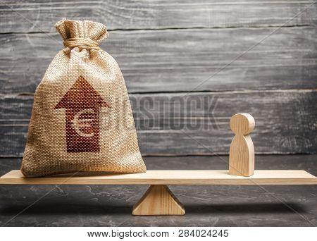 Euro Money Bag With Up Arrow And Man Figurine On Scales. The Average Salary In The Labor Market, Pri