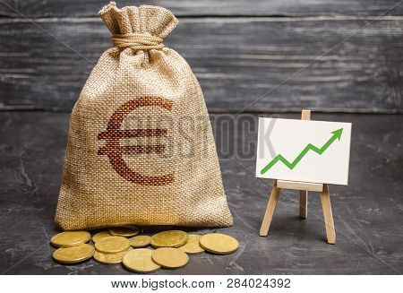 Bag With Euro Money And Green Arrow Up On The Chart. Success, Achieving Good Results. The Concept Of