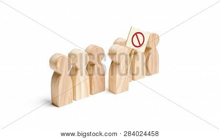 The Person's Figure Comes Out Of The Line With A Sign. An Angry Mob Of Wooden Figures Of People With