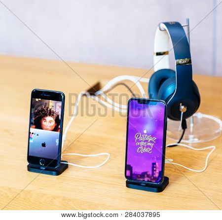 Paris, France - Dec 16, 2018: Apple Computers Iphone Xs Next To Iphone 8 Telephone Smartphone On Woo