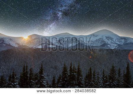 Mountain Winter Night Panorama, Christmas Landscape. Steep Long Ridge Mountain Peaks Covered With Sn