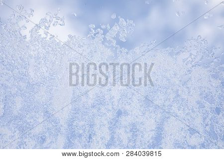 View From The Window Covered With Snowflakes