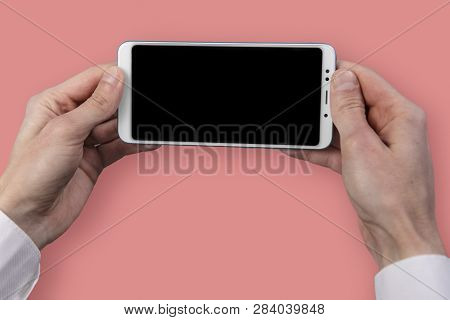 Mans Hand Holding Black Screen Mobile Phone