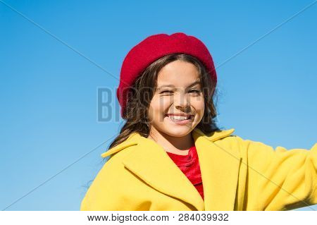 Things Gonna Be Alright. Girl Wink Cheerful Face Blue Sky Background. Kid Girl Wear Hat And Coat Che