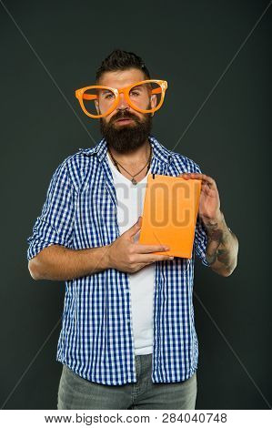 Hipster Bearded Man Wear Funny Eyeglasses Hold Notepad Or Book. Bright Up Your Day. Read This Book.