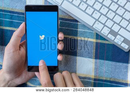 Chiang Mai, Thailand - Mar 28,2018: : Man Holding Huawei With Twitter App On The Screen.twitter Is A