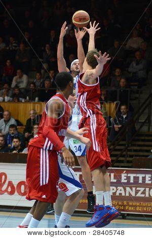 KAPOSVAR, HUNGARY - NOVEMBER 19: Michael Fey (in white) in action at a Hugarian National Championship  basketball game Kaposvar (white) vs. Paks (red) November 19, 2011 in Kaposvar, Hungary.