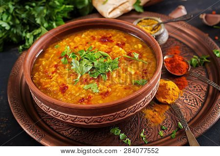 Indian Dal. Traditional Indian Soup Lentils.  Indian Dhal Spicy Curry In Bowl, Spices, Herbs, Rustic