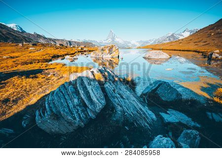 Famous peak Matterhorn (Cervino) in sunny day. Location place Stellisee, Switzerland, Valais region, Swiss alps, Europe. Scenic image of most popular tourist attraction. Discover the beauty of earth.