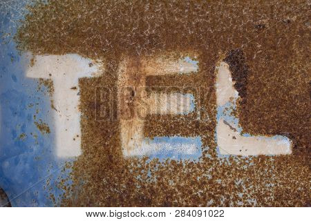 Letters On Rusty Metal, Letter T, Letter E, Letter L, Word On Over Blue Texture Of Rusty Metal, Rust