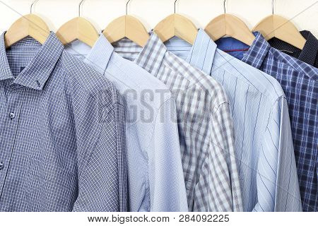Collection Of Blue Shirts On Hangers, Men S Fashion
