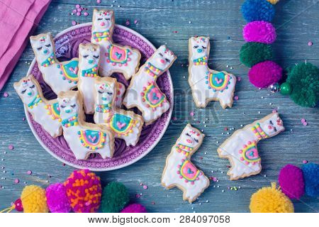 Llama cookies on a wooden background