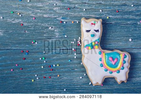 Llama cookie on a wooden background