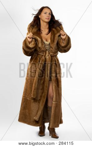 Beautiful Young Woman In A Fur Coat.