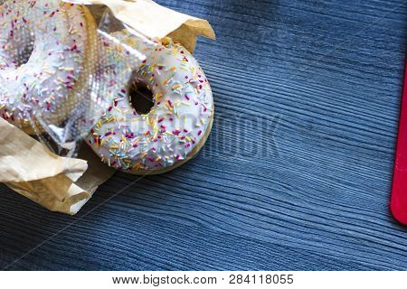Flat Lay Top View Of The Donuts Bought In The Bakery Shop, Packed In A Paper-plastic Bag And Thrown