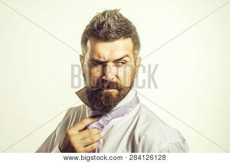 Bearded Handsome Businessman Fixing Tie On Neck. Man Adjusting Tie. Businessman Wearing Or Tighten N