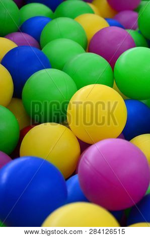 Swimming Pool For Fun And Jumping In Colored Plastic Balls