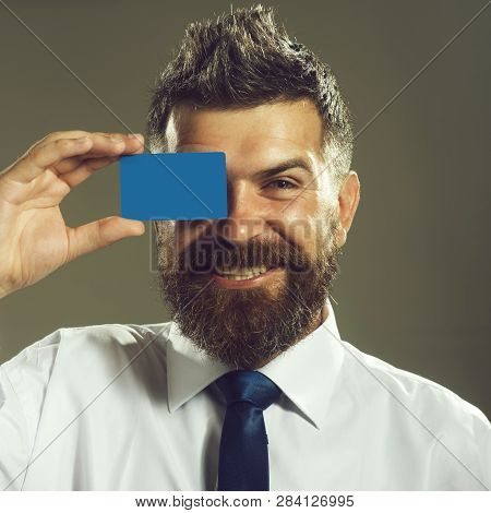 Smiling Business Man Covered Eye With Credit Card. Handsome Man In White Shirt With Credit Card. Cas