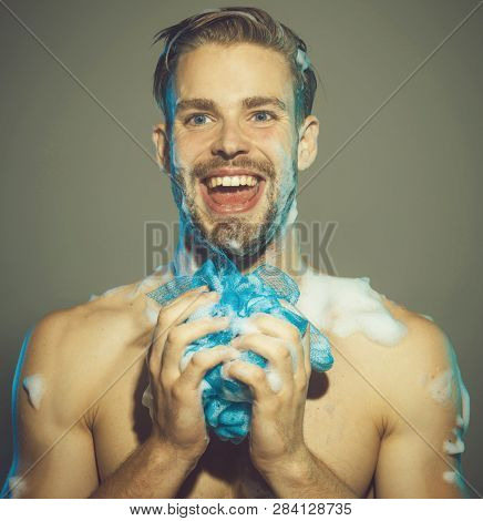 Men's Cosmetics For Body Care. Attractive Man Taking Shower. Male Body With Sexy Strong Torso. Man W