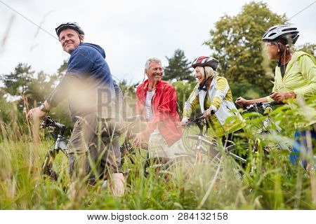 Group of seniors on a bike tour or bike tour as a cycling holiday
