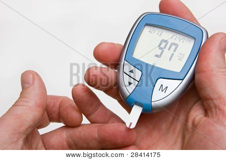 Person Checking Their Blood Sugar