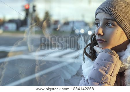 Eenager Girl.girl Teenager Sits On The Bus And Looks Out The Window,teenager Girl Is Sitting In The