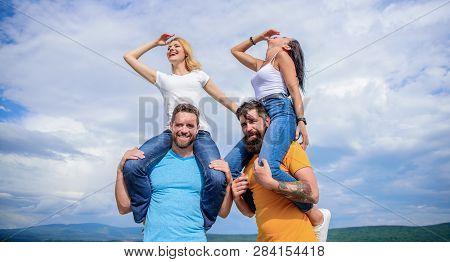Having Huge Fun. Loving Couples Enjoy Fun Together. Happy Men Piggybacking Their Girlfriends. Loving