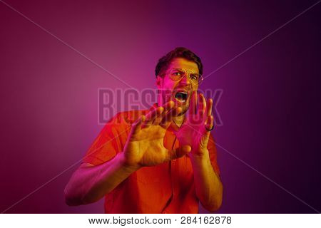 Im Afraid. Fright. Portrait Of The Scared Man. Business Man Standing Isolated On Trendy Pink Studio