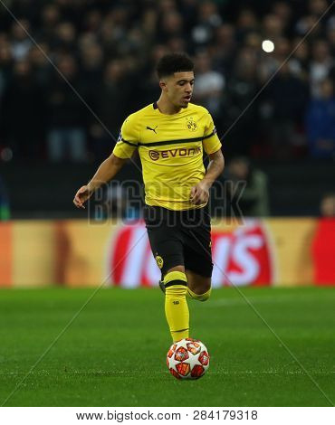 LONDON, ENGLAND - FEBRUARY 13 2019: Jadon Sancho of Dortmund during the Champions League match between Tottenham Hotspur and Borussia Dortmund at Wembley Stadium, London.