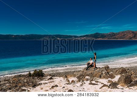 Couple In Love In The Blue Lagoon. Lovers On The Coast. Boy And Girl In Turkey. Couple On Beach. Man