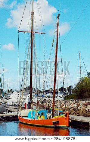 Vintage Old Style Sailing Boat Berthed At Tin Can Bay, Queensland, Australia. Brilliant Blue Sky Bac