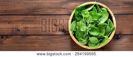 Fresh Spinach Leaves On Wooden Background. Healthy Vegan Food. Top View. Banner