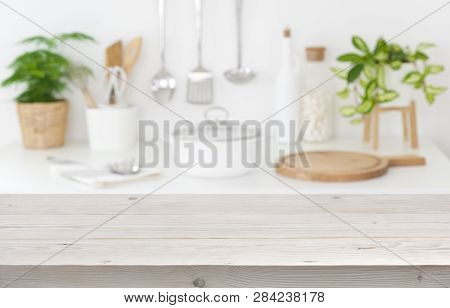 Empty Tabletop Over Blurred Kitchen Cooking Place For Product Display