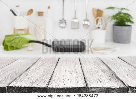 Vintage Wooden Planks In Front Of Defocused Kitchen Counter Background