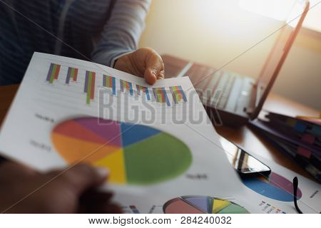 Colleagues submitted trade data chart document to each other. Business and Office life concept. poster