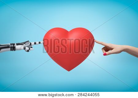Womans Hand On The Right And Robots Hand On The Left Touching Red Valentine Heart With Their Fingert