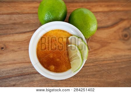 Creme Brulee - Traditional French Vanilla Cream Dessert With Caramelised Sugar And Lime