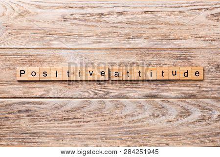 Positive Attitude Word Written On Wood Block. Positive Attitude Text On Wooden Table For Your Desing