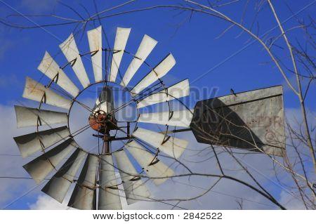 Windmill aeromotor against brilliant blue sky