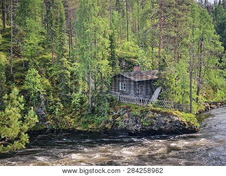 Old Fishermans Hut Along The Oulankajoki River At The Oulanka National Park In Kuusamo, Finland. Sce