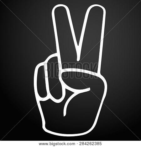 Hand Gesture Victory Symbol On A Dark Background.