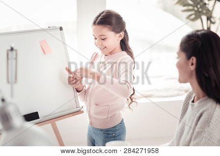 Helping Daughter Helping Self-employed Mother Planning Time Near Whiteboard