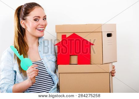 Happy Woman Moving In Carrying Cartons Boxes With Red Paper House And Key. Young Girl Arranging Inte