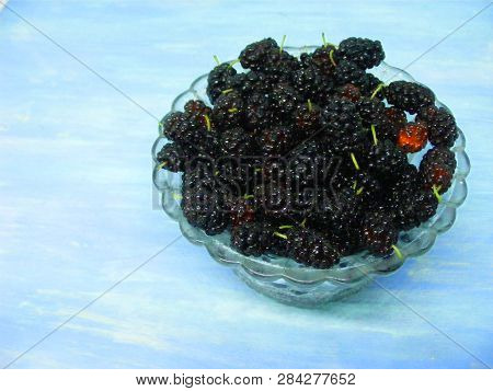 Fresh Black Mulberry In Crystal Bowl On Blue Shabby Table