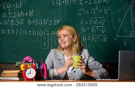 Woman Drink Coffee In Classroom. Teacher With Alarm Clock At Blackboard. Time. Back To School. Teach